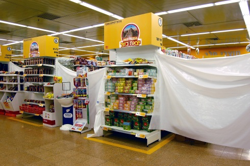 Plastic sheeting blocks off aisles containing foods that are not kosher for Passover