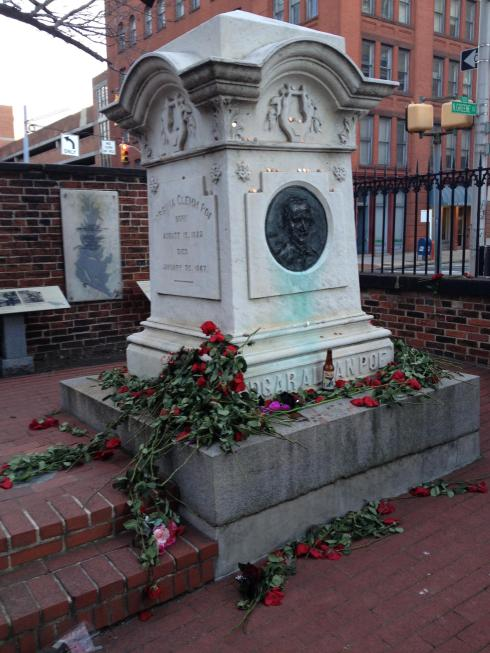 Roses laid at the tomb of Poe and his child bride Virginia Clemm Poe on the night of the Birthday Bash.